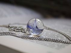 #boho #pendant orb made of crystal eco-resin with with real #cornflower. *Price 25 USD*  #resinjewelry #necklaces