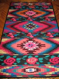 Beautiful antique traditional Romanian woven wool carpet / rug with both floral and geometrical pattern . Hand woven in Northern Transylvania 50-60 years ago . Hand woven with wool on cotton thread foundation . Size 130 cm x 210 cm or 4. 26 x 6. 88 feet www.greatblouses.com