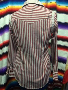 Interesting gray and burgundy striped western shirt by H bar C. This shirt is marked size 32, fits like a modern small. It has a Peter Pan collar and Pearl snaps.  Additional measurements upon request.