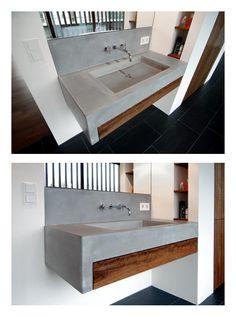 Ein schönes Waschbecken aus Beton wertet dieses Bad ungemein auf. Quelle: material raum form