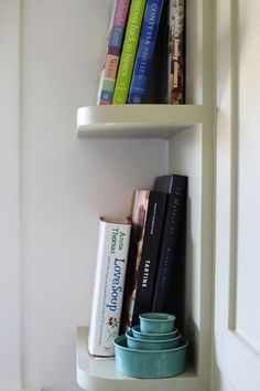 remove the door to the end cabinet and leave shelves open for cookbooks :)