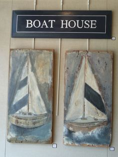 Boat House sign and sail boat paintings on reclaimed wood