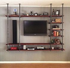 DYI Industrial pipe entertainment center.