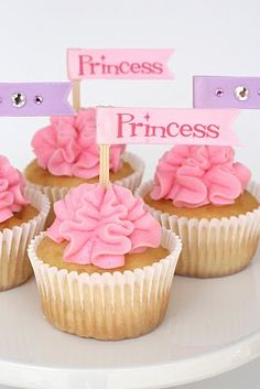 Pink ruffled frosting with pink and lavender ribbon flags... a combination fit for any princess.