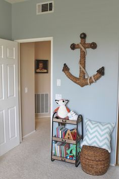 Nautical Theme Nursery. Love the anchor with the rope around it