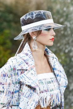 Spring 2018 Trends: Fashion Week Coverage - Plastic Hat- Chanel - Vogue