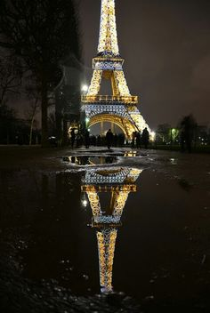 Rainy night at the Eiffel Tower.