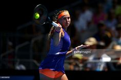 Kristina Mladenovic of France plays a forehand in her first round match against Sabine Lisicki of Germany during day one of the 2015 Australian Open at Melbourne Park on January 19, 2015 in Melbourne, Australia.