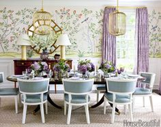 "The dining room's scenic wallpaper, de Gournay's Jardinieres Citrus Trees, handed Whittaker a ""launching palette"" for the azure of Hines & Company's Moccasin upholstery on J. Alexander chairs and the lavender of curtains in a Manuel Canovas fabric. Canary Grande pendants are by Chameleon Fine Lighting and the Patricia lamps, by Christopher Spitzmiller. The Stratum rug is from Merida."