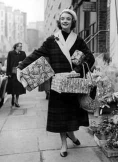Coats get longer and bags finally get bigger in 1956. Holiday shopping has never looked so fab.