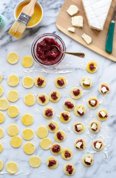 Mini Baked Brie- Cut out puff pastry and stuff with cranberry and Brie, could also use your favorite Preserves.