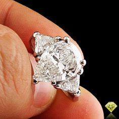 4.35ctw Platinum Pear Teardrop Cut Diamond Three (3) Stone Engagement Ring