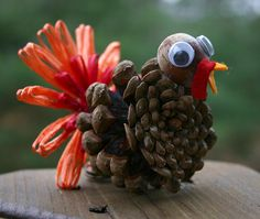 another little pinecone turkey is part of Thanksgiving crafts Pine Cones - up close pic of my pinecone turkeys made with acorn heads and vintage Swistraw ribbon flower tails Thanksgiving Crafts For Kids, Thanksgiving Decorations, Fall Crafts, Holiday Crafts, Turkey Decorations, Thanksgiving Turkey, Pine Cone Art, Pine Cone Crafts, Pine Cones