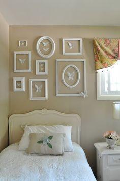 A girls bedroom with collaged flea market frames