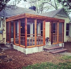 Screened porch made from inexpensive screen doors - genius!