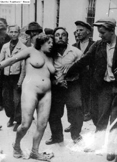 A Jewish woman standing naked on a Lvov street, surrounded by Ukrainian rioters, during the pogroms of early July 1941.