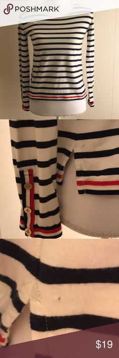 "J. Crew Nautical Shirt Adorable shirt, navy and white stripes, gold button and red ribbon accents on sleeves. Only imperfection is tiny hole on bottom right side (see picture).   Size is listed as XXXS. In my opinion, it's more of an XS/XXS, but see measurements.   100% Cotton  16.5"" bust 21"" length 21"" sleeves J. Crew Tops Tees - Long Sleeve"