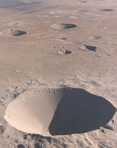 """Nuclear bomb craters at Yucca Flat, Nevada Test Site, Nevada. """"Sedan"""" crater, in foreground by EvolvePhotostream, via Flickr"""