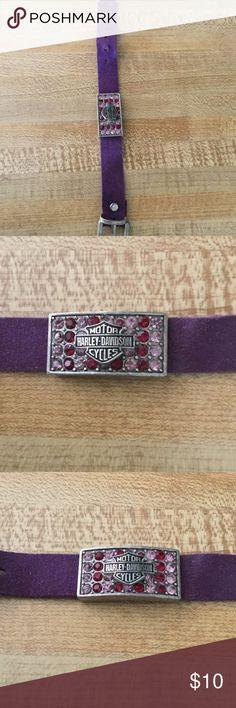 Harley Davidson bracelet Purple suede strap ..with Harley emblem...it fastens like a watch band....the emblem has pink an purple stones..... Harley-Davidson Jewelry Bracelets
