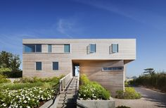 Bay House by Leroy Street Studio in Long Island, New York, USA, completed in 2009. The cedar-clad house incorporates expansive views of the bay, and has a narrow boardwalk leading off the deck to t...
