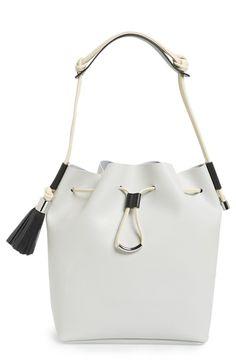 white drawstring bucket bag with black trim