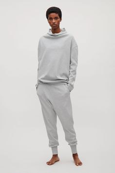 This sweatshirt is made from cotton jersey with a melange finish. A casual fit, it has dropped shoulders and a grown-on, standing collar that softly drapes around the neck. Wear with the matching tapered jersey trousers.