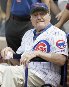 Lone living Cub in World Series returns to Wrigley......Former Chicago Cubs shortstop Lennie Merullo looks to the field before throwing out a ceremonial first pitch before a baseball game between the Miami Marlins and the Chicago Cubs in Chicago, Saturday, June 7, 2014. Lennie Merullo is the only living Cubs player to have played in a World Series..