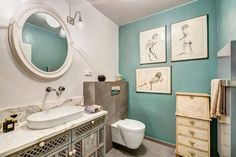 Bathroom.Blue wall accesorized with a collection of paintings and wardrobe cupboard from India. #interior #design #indian #blue #bathroom
