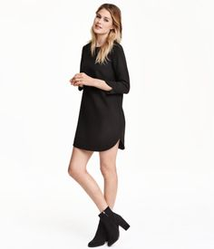 Short, straight-cut dress in thick jersey. Opening at back of neck with concealed button, 3/4-length sleeves with slits at cuffs, and a gently rounded hem. Unlined.