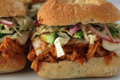 chipotle BBQ smoked pulled chicken sliders with goat's milk cheddar, avocado, slaw and red onion
