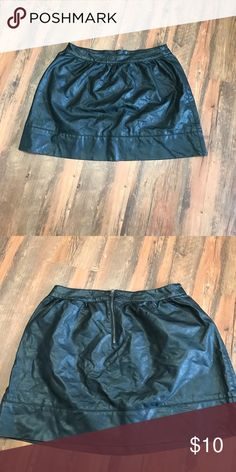 Black Faux Leather Mini Skirt This skirt can be dressed up or down! It has an exposed gun metal colored zipper on the back. It's not too short and can be worn high waisted or on the hips. Rue 21 Skirts Mini