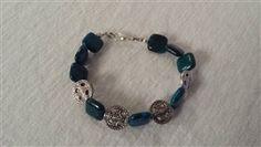 Blue Zoisite Bracelet With Silver Tone Spacershttp://www.northerngems.ca/turquoise-chip-bracelet-p/heidi.htm..$16.00
