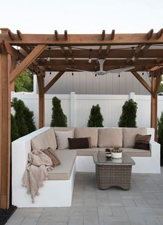 Organic Gardening Supplies Needed For Newbies White Concrete Outdoor Sofa Under Pergola With Outdoor Fan, String Lights, And Paver Patio Outdoor Pergola, Backyard Pergola, Pergola Plans, Pergola Kits, Outdoor Sofa, Outdoor Living, Outdoor Decor, Pergola Ideas, Cheap Pergola