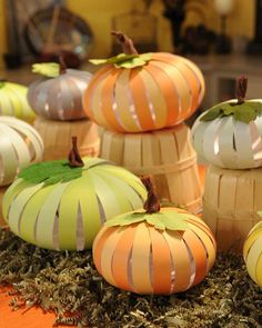 Create a pretty patch of decorative pumpkins using scrapbook paper and a screw punch. Pumpkins can be folded and stored by removing the bottom brad from the holes and collapsing the strips. To make a smaller pumpkin, cut 9 9-inch by 7/8-inch strips from two colors and tie 4 inches of twine between brads.Resources: 12-by-12 paper packs in neutrals, brights, or pastels; paper trimmer; and screw punch from Martha Stewart Crafts. Floral (heavyweight) crepe paper from Castle in the Air.