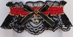 Wish No More. Red & Black Garter with a Gold Love Charm attached. Black lace and Hot Red Moire' Band with a gold edge.  Garters for Wedding - Bridal - Prom - Fashion. Fancy Bands Garter Style # B-250M-Love / Visit: www.garters.com/page35a.htm