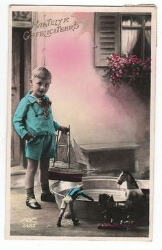 vintage postcard boy with boat