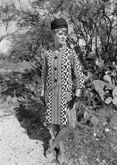 """A """"Hemisfare Hostess"""" modeling the official hostess uniform for the 1968 San Antonio Hemisfair world's fair."""