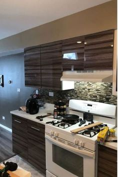 The perfect way to give an old-world feel to your kitchen is to use our High Gloss Washed Oak cabinet doors. It offers a stunning variation in color ranging from deep browns to lighter shades akin to mocha and a touch of caramel. These various shades will fit seamlessly into the overall design of the room you are designing. It is a look frequently utilized in a kitchen because it's a well-worn but well-loved decorating option. #27estore #woodencabinets #oakdoors
