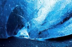 An ice palace deep inside the Vatnajökull ice cap in Iceland. Vatnajökull is the largest ice cap in Europe, around 743 cubic miles, covering about 11% of Iceland, and constantly changing its formation due to the melting of the glacier.