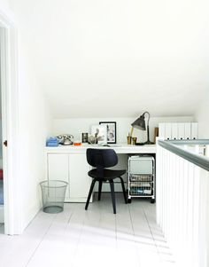 Maximizing space: a second-floor landing turned home office. #offices #decoratingideas #whiterooms