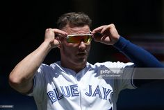 Josh Donaldson #20 of the Toronto Blue Jays adjusts his sunglasses after being stranded at the end of the first inning during MLB game action against the Houston Astros at Rogers Centre on July 8, 2017 in Toronto, Canada.