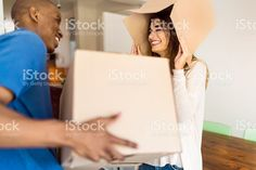Man looking at happy girlfriend playing with box royalty-free stock photo