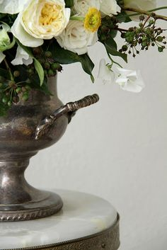 pretty flowers in antique silver vase