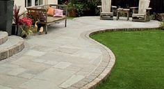 Soft curve for paved area under the balcony with stone mosaic edging - refer to other photo below