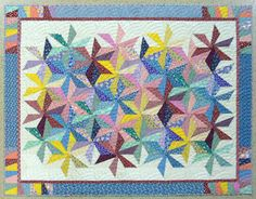 Ruthie's version of Spinout with gorgeous Baptist Fan quilting.