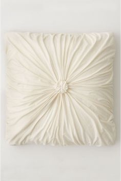 My inspiration came from this Rosette pillow from Anthropologie ($58). It is really simple to make and adds a very elegant touch to any r...