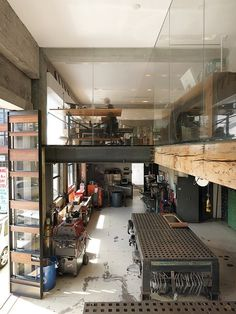 The first floor houses a machine shop--where prototypes for LED lighting and folding glass facades are fabricated for Larissa's architecture office, housed on the second floor along with Jeff's industrial design studio.