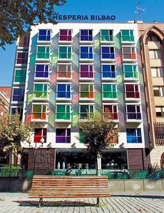 Hotel Hesperia Bilbao in Spain beckons weary travelers with its Jolly Rancher–hued crystal windows.