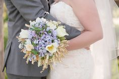 Bridal bouquet with delicate pale blue Virginia bluebells and white tulips. Venue: Historic Rockland | Lelia Marie Photography | Coordinator: Simplicity Events by Johanna | Flowers: Buttercups Floral Design | Bridal Makeup and Hair: Enlightened Styles