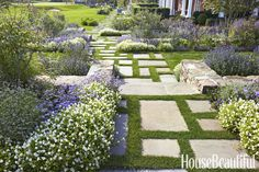 Think of your garden as an organized procession, advises Hollander. Stone steps and offset paversprovide structure and allow the garden to reveal itself in an interesting way.